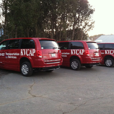 Lettering on a fleet of vans for the KVCAP program
