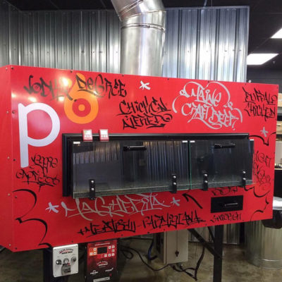 Custom graffiti style lettering adorn this oven at Pizza Degree in Waterville