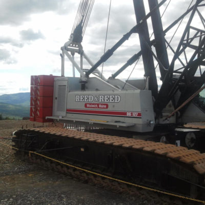 Sometimes our work comes with a view! Such as the case with this crane that we lettered on a mountain top for Reed & Reed of Woolwich.