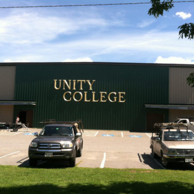 The gold letters on this building for Unity College are 4ft tall and can be seen from a country mile.