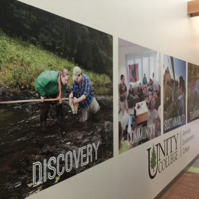 Mural decals and lettering in the halls of Unity College